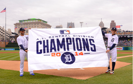 DETROIT, MI - APRIL 06: Anibal Sanchez #19 (L) and Ian Kinsler #3 of the Detroit Tigers hold up the 2014 A.L. Central Division Championship banner prior to the Opening Day game against the Minnesota Twins at Comerica Park on April 6, 2015 in Detroit, Michigan. The Tigers defeated the Twins 4-0. (Photo by Mark Cunningham/MLB Photos via Getty Images)
