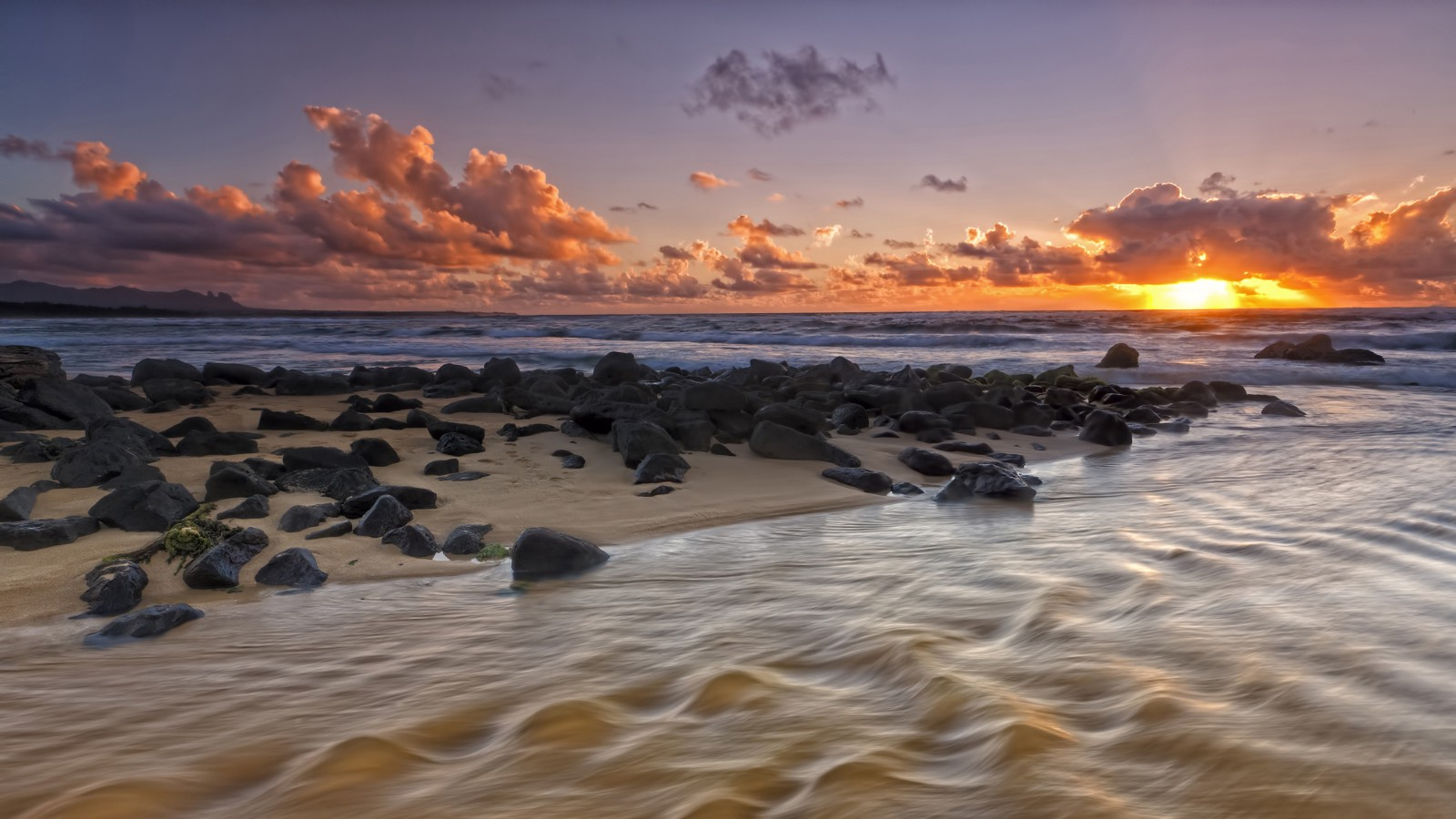 Sunrise over Nukoli'i Beach and stream, Kauai, Hawaii