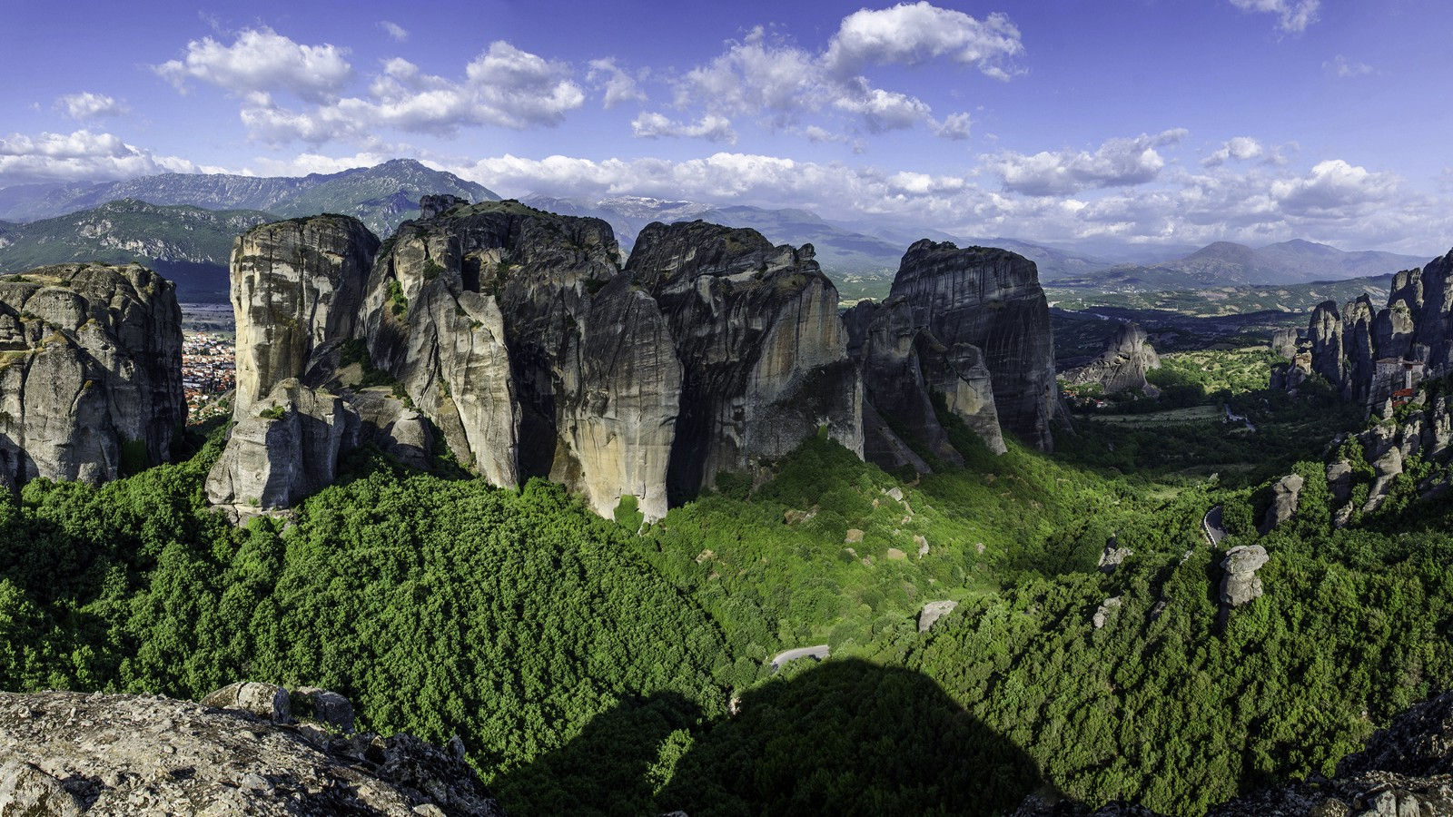 Panoramic view of Meteora, a collection of monasteries at the top of a group of stone pillars in Greece