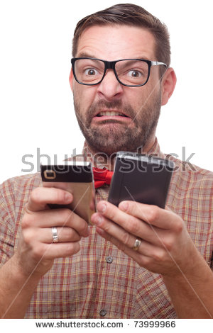 A terrible stereotype of a nerdy guy trying to use a two cell phones