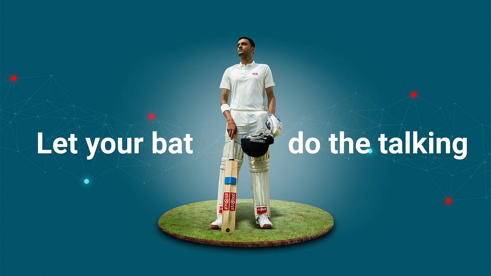 Cricketer holding a bat equipped with str8bat IoT