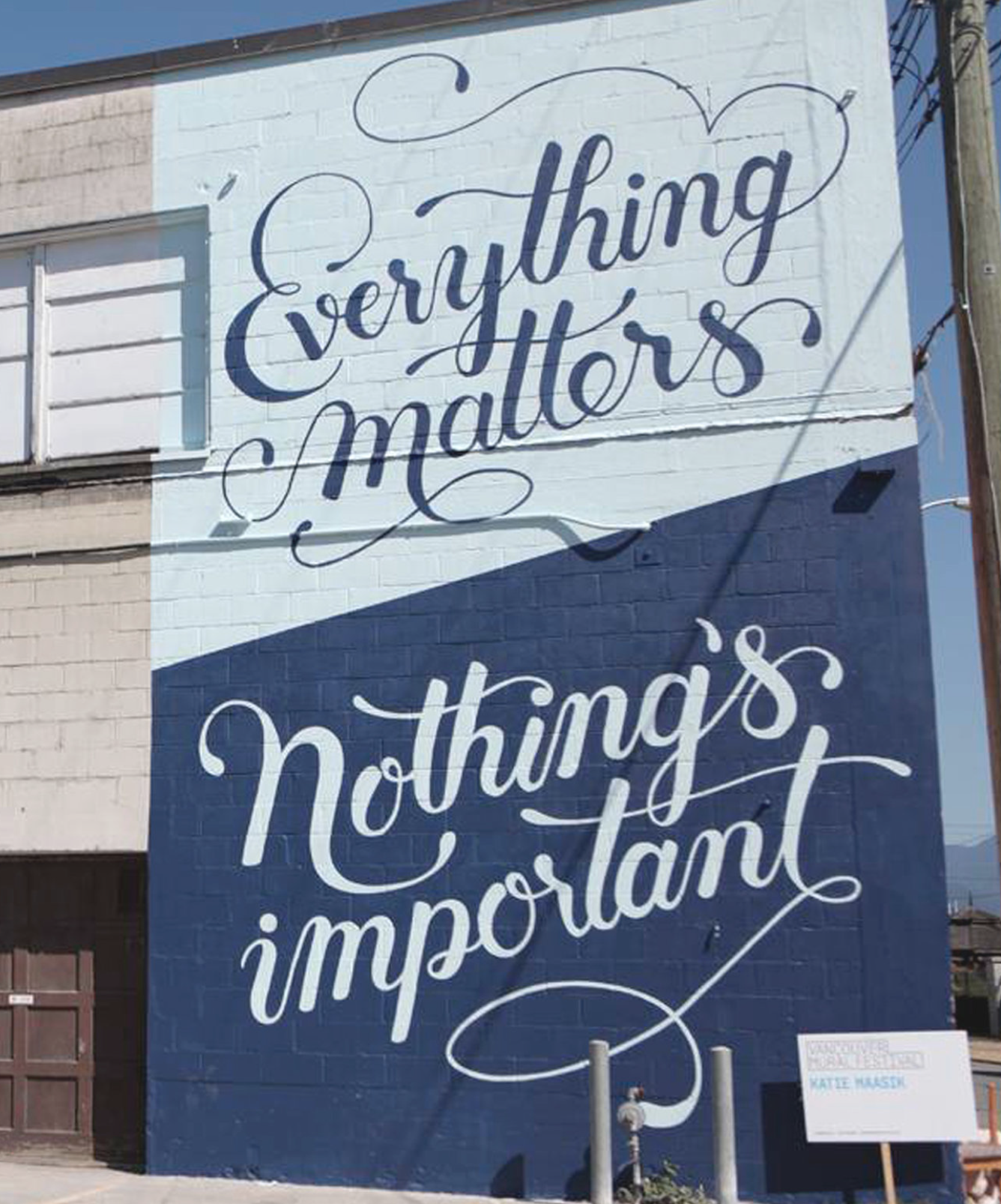 """Mural white with bleu script on top and blue with white script below. The top read reads """"Everything Matters"""" and below """"Nothing's important"""""""