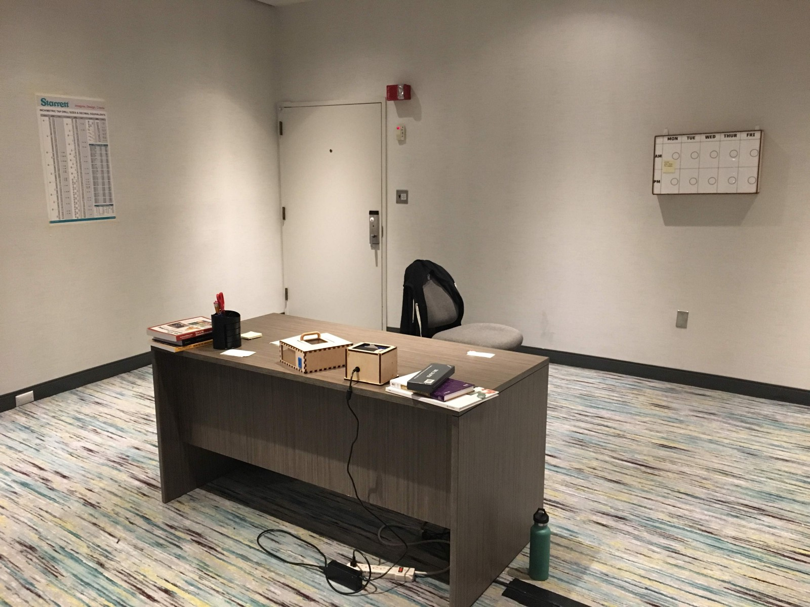Designing A Pop Up Room Escape Tiffany Tseng Medium Book Wiring Observation Posters And Whiteboard Are Mounted On The Wall While Lockbox Printer Placed Desk Along With Series Of Books Pen Holder