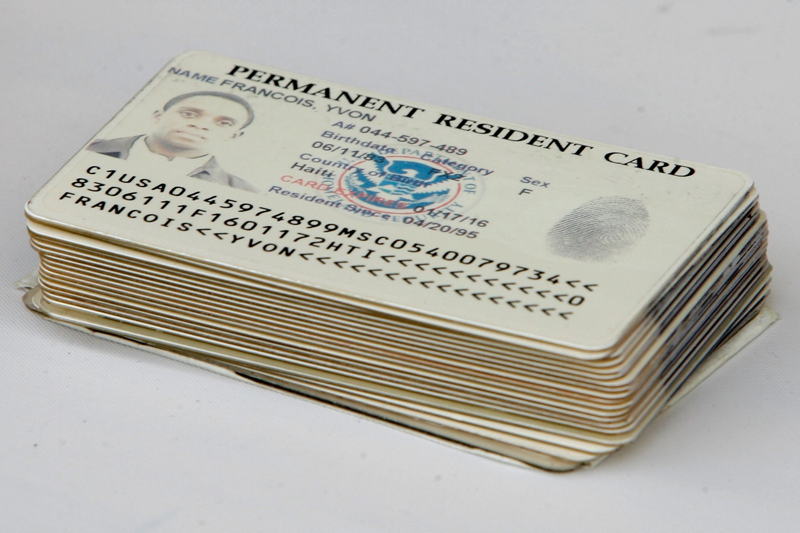 The faces of immigrants becoming citizens are what the american a stack of permanent resident cards turned in by soon to be citizens ahead of a naturalization ceremony in washington dc in 2008 xflitez Choice Image