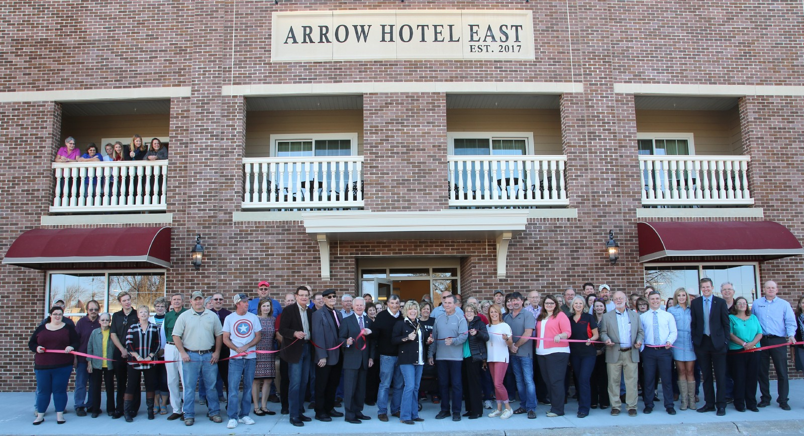 Arrow Hotel East Formally Cuts The Ribbon And Beckons Guests To Broken Bow Those Pictured Above Include Owners Rj Anne Thomas Matt Cathy
