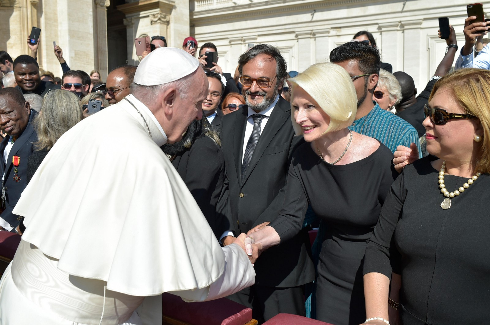 Pope Francis greets U.S. Ambassador to the Holy See Callista Gingrich in St. Peter's Square, October 3, 2018, during the Opening Mass for the 2018 Synod of Bishops.
