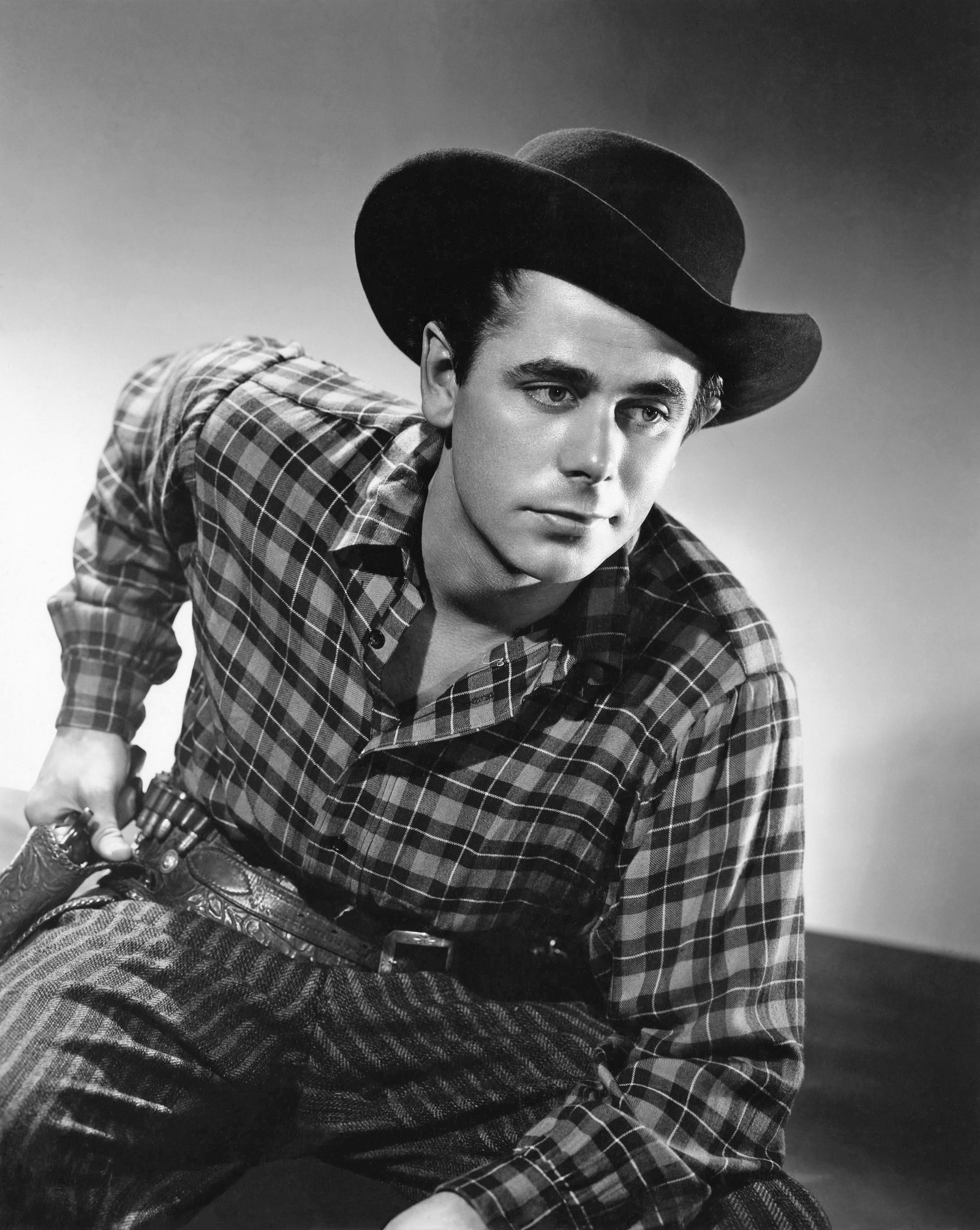 """b2fbc74793b02 A stark black and white still depicts Glenn Ford trying to turn over a new  leaf as notorious outlaw Cheyenne Rogers in """"The Desperadoes"""