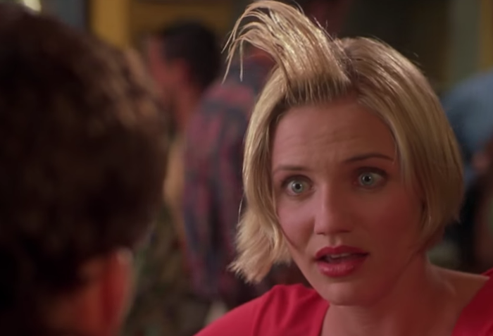 """photo still from """"There's Something About Mary"""": Cameron Diaz with """"hair gel"""" in her hair"""