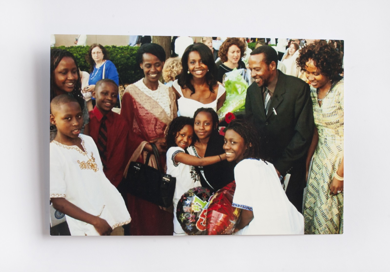 Clemantine Center Top Graduating From New Trier High School In Illinois Surrounded By Her Rwandan Family Mom And Dad On Left Right