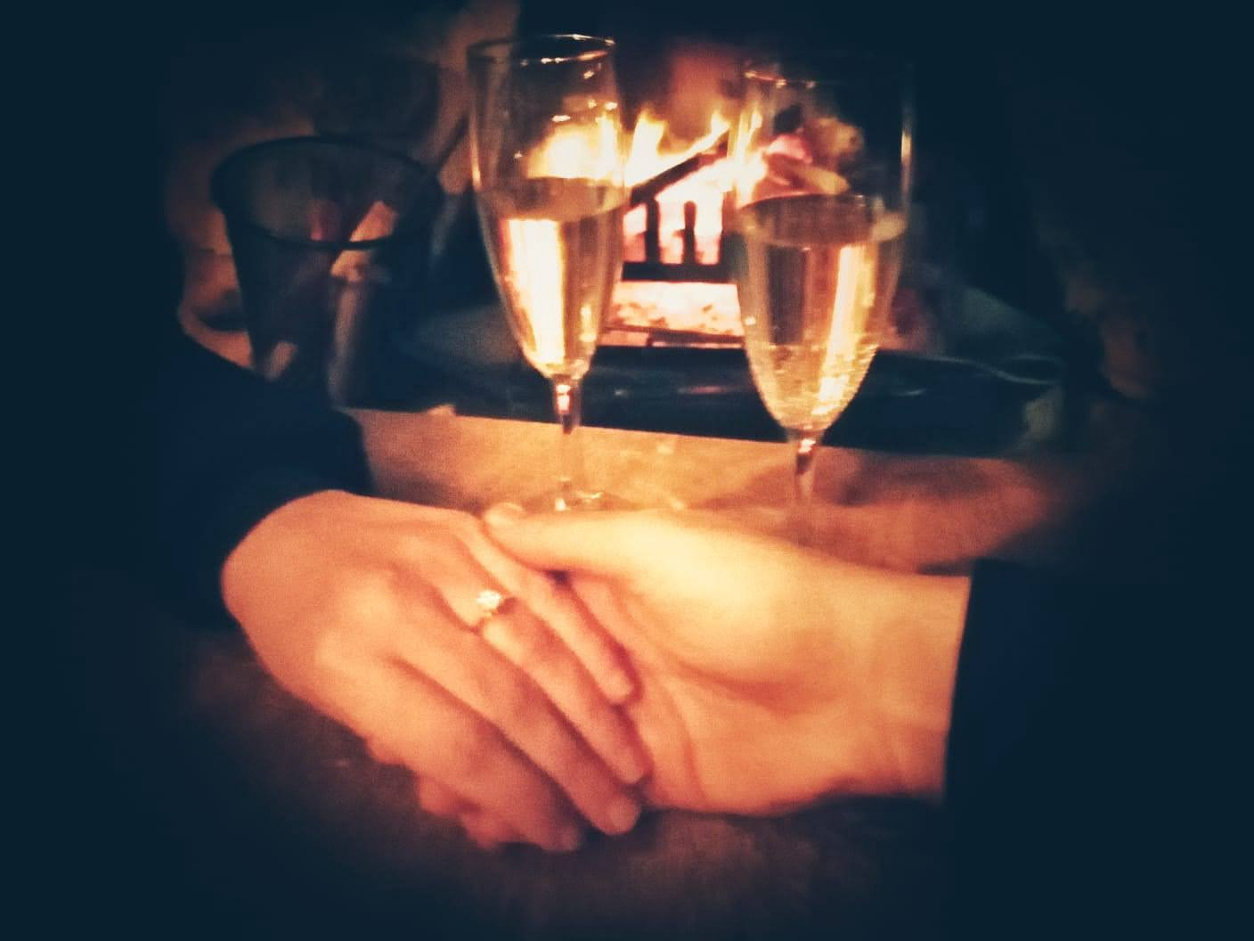 Hands holding, where one has an engagement ring