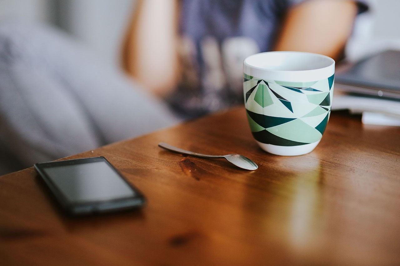 coffee cup and phone