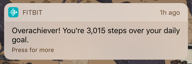 Another push notification. It reads: Overachiever! You're 3,015 steps over your daily goal. This is not a good thing.
