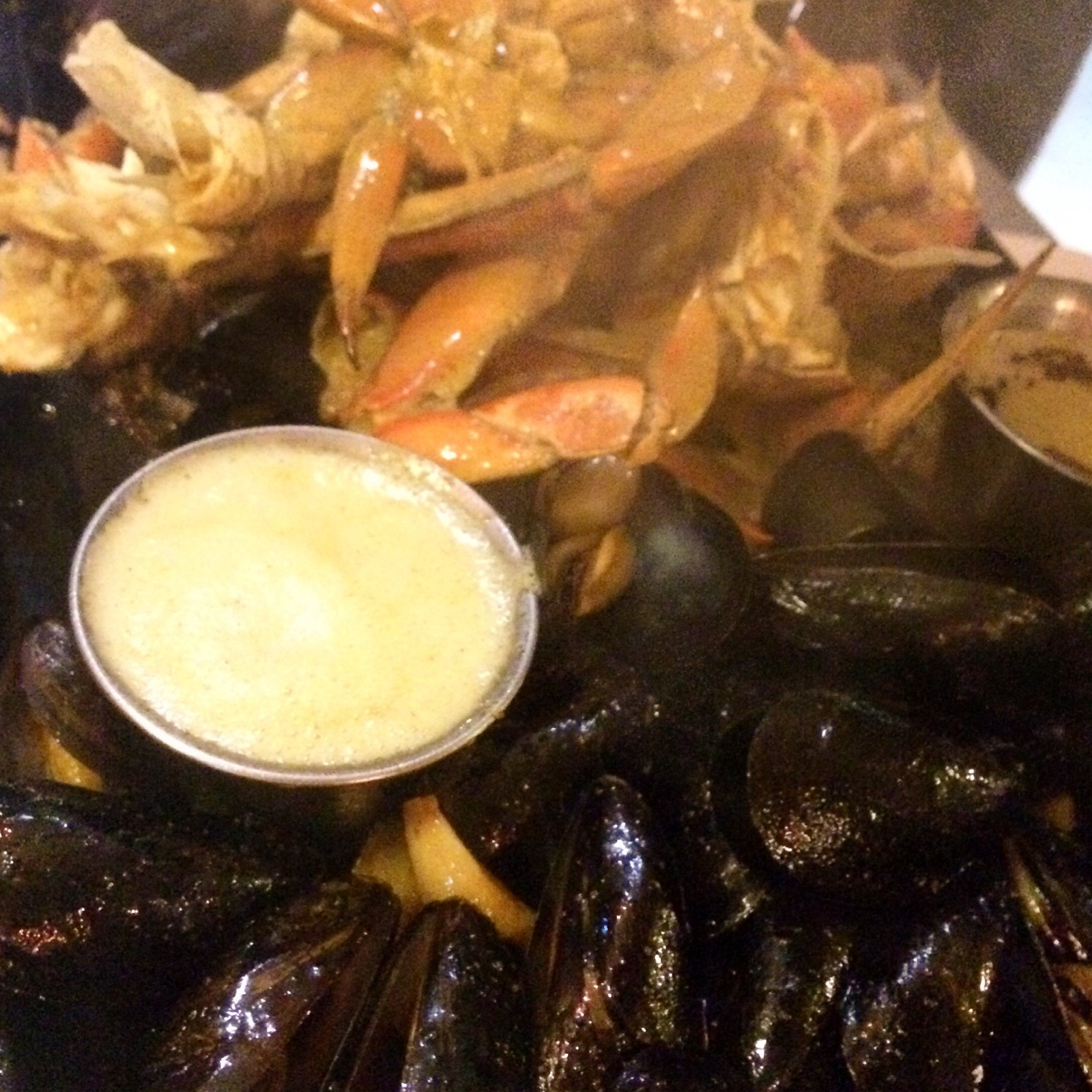 You can't go wrong with roasted mussels, crab, drawn butter and garlic sizzling over an iron skillet.