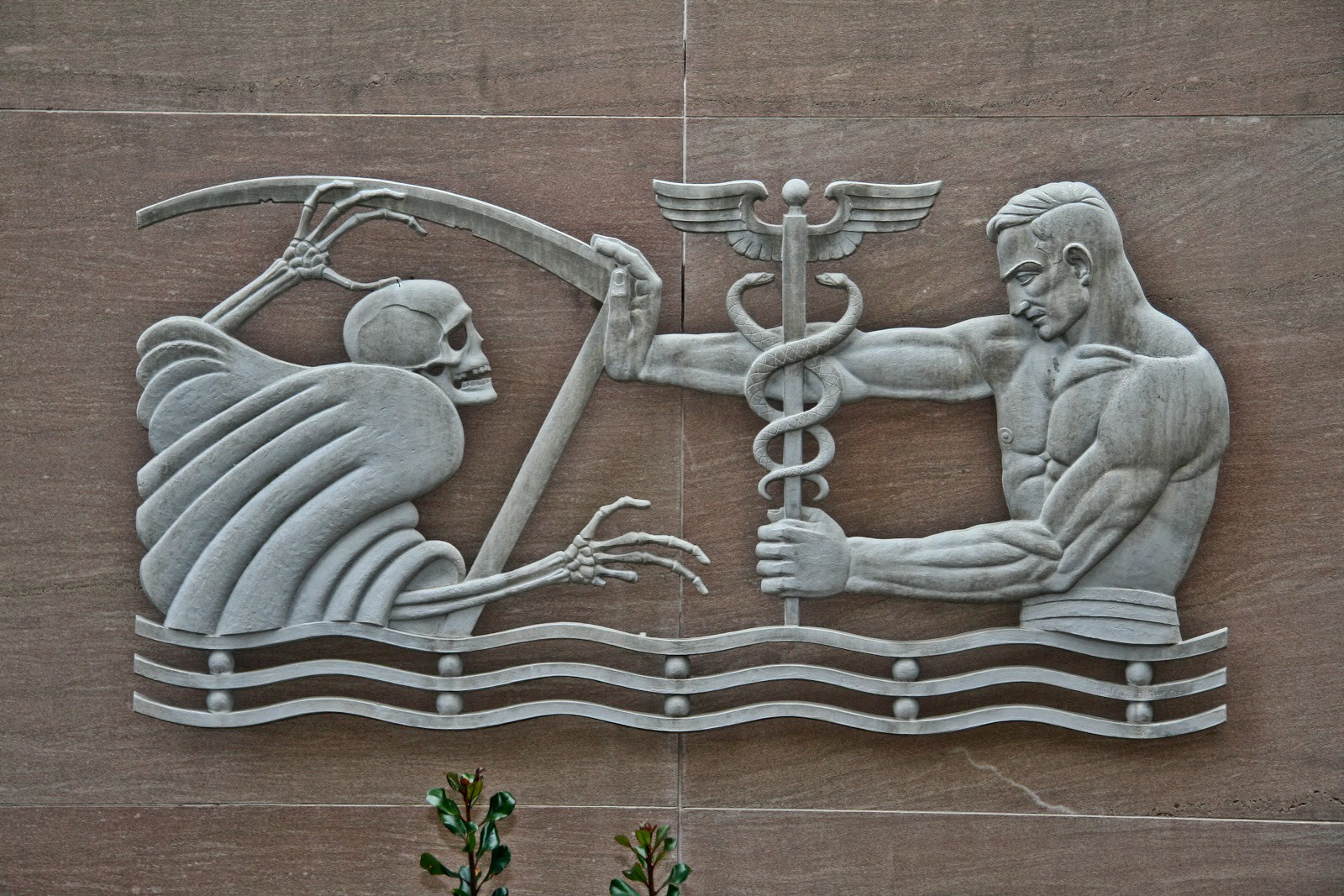 Symbols sculptures the us army medical corps and a building in in this darker sculpture we see the personification of death wielding a scythe fighting hermes the greek god of transitions and boundaries messenger to buycottarizona Gallery