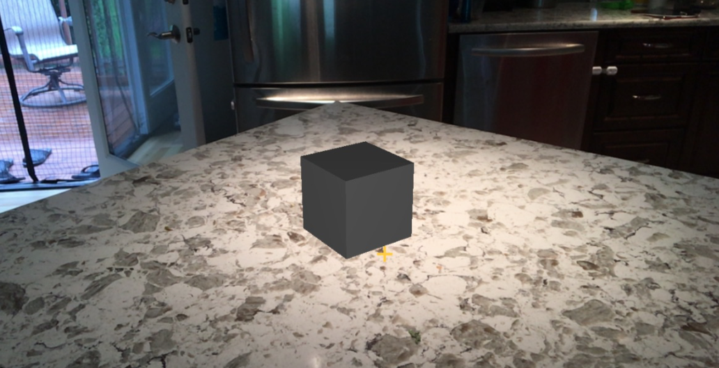 dark cube in bright room