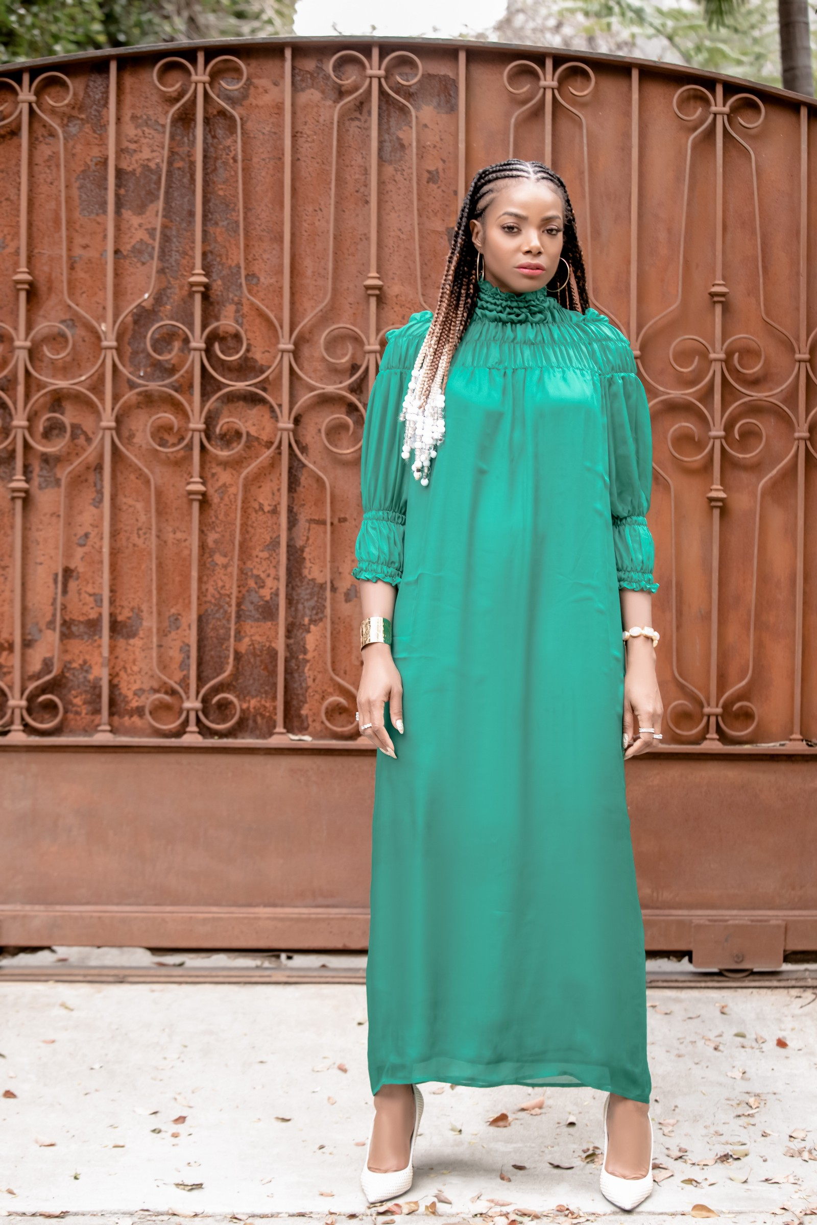 Tai Beauchamp wearing the emerald green maxi dress by Bastet Noir