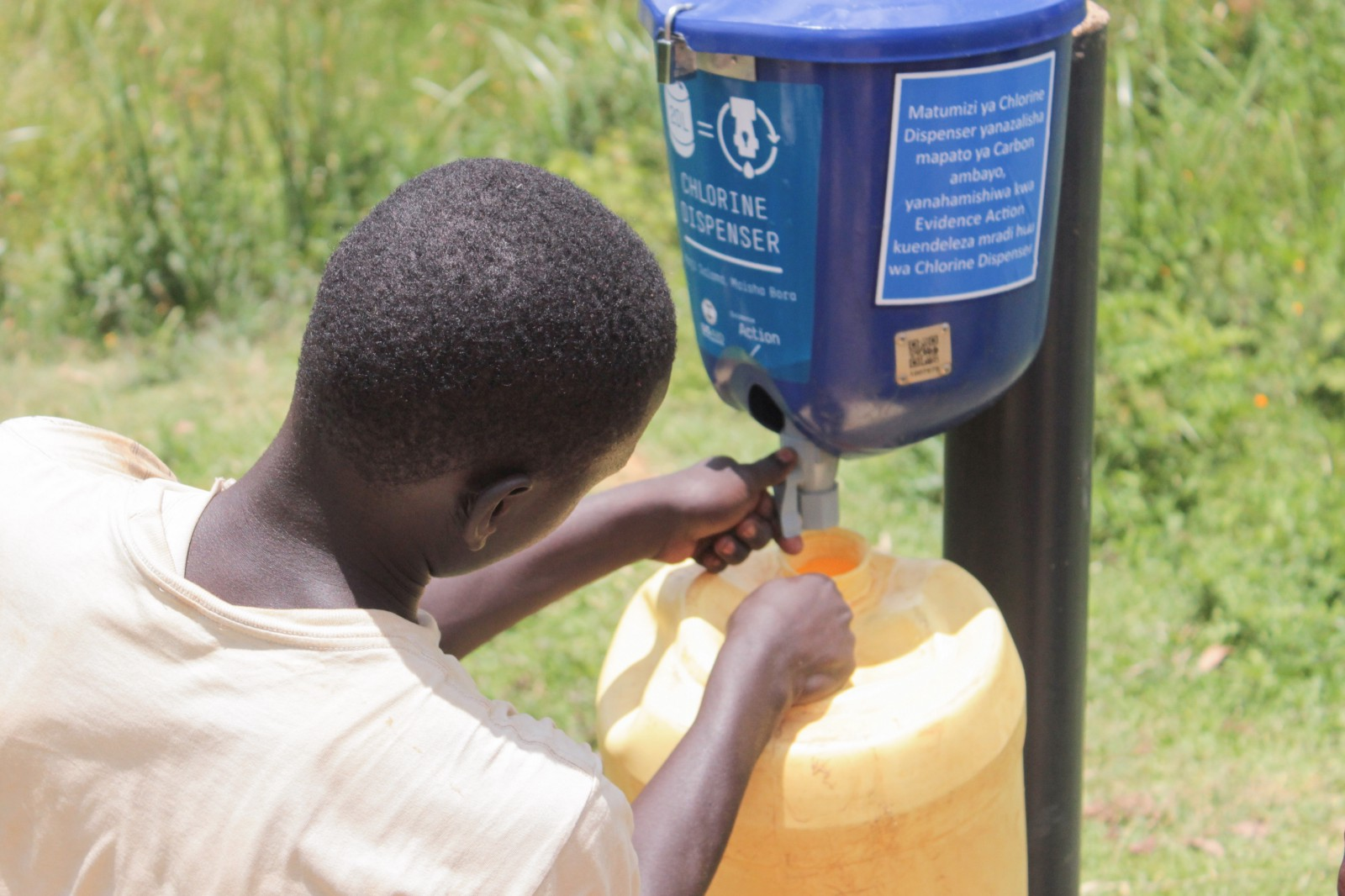 A customer collects safe water in a jerry can.