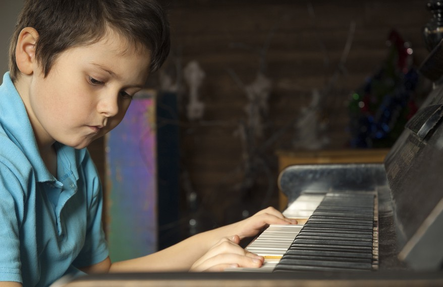 What are the goals for a child's first piano lesson?