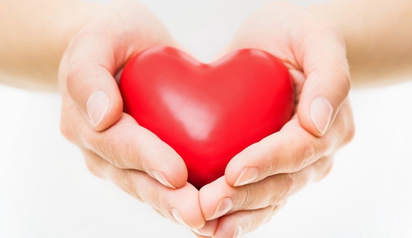 Image result for large image of man giving woman a heart in her hands