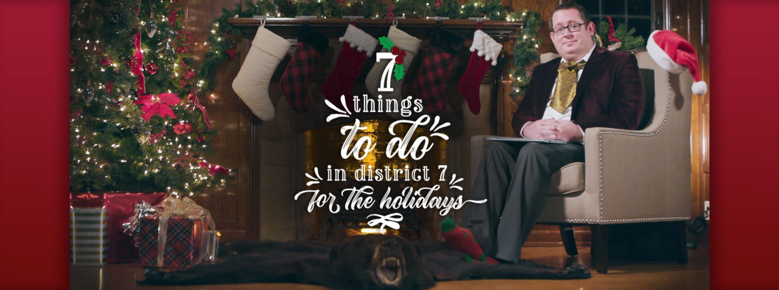 Councilmember Derek Young sitting next to a fireplace, Christmas tree, with over the top decorations and clothes, promoting 7 things to do in District 7 for the Holidays.