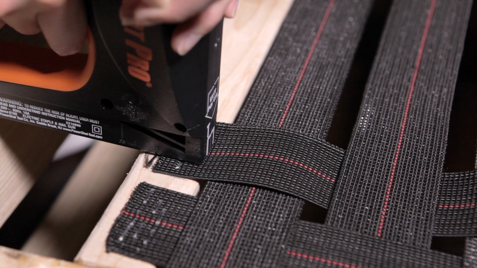 Stapling The Ends Of The Webbing To The Frame.