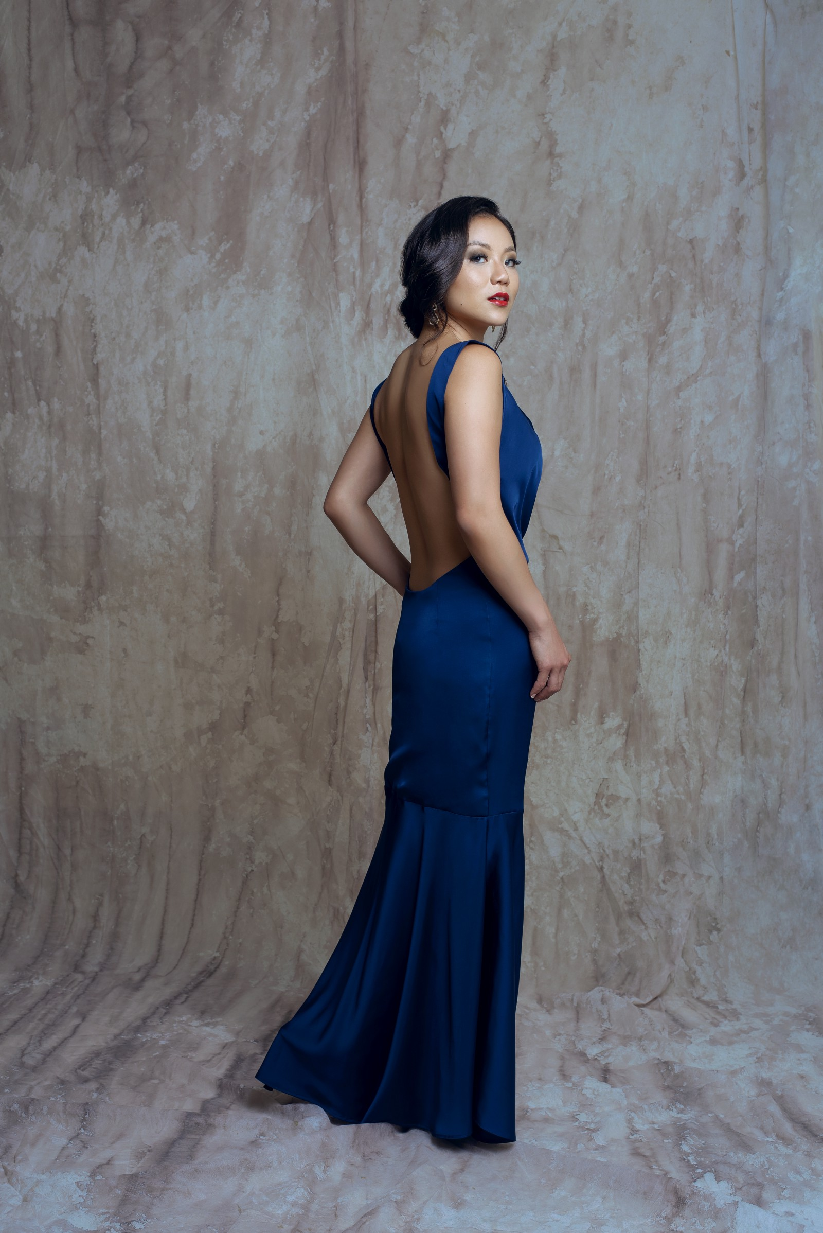 Sarah Chen wearing the Michelle Dress in midnight blue by Bastet Noir, photo by RaisaAzam, MUA: pearltji