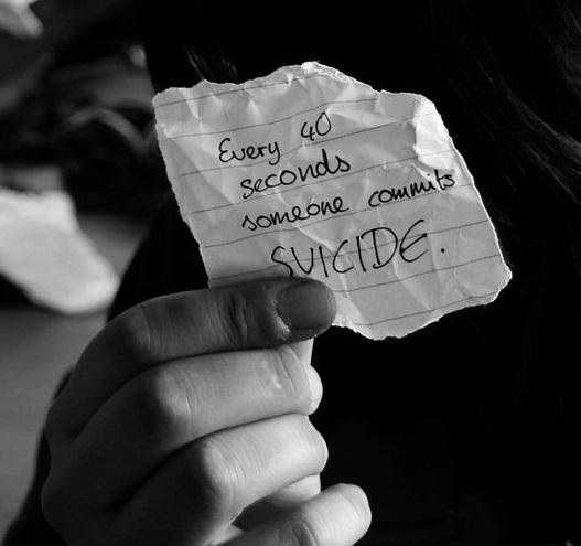 """Every 40 seconds someone commits suicide"" written on paper."