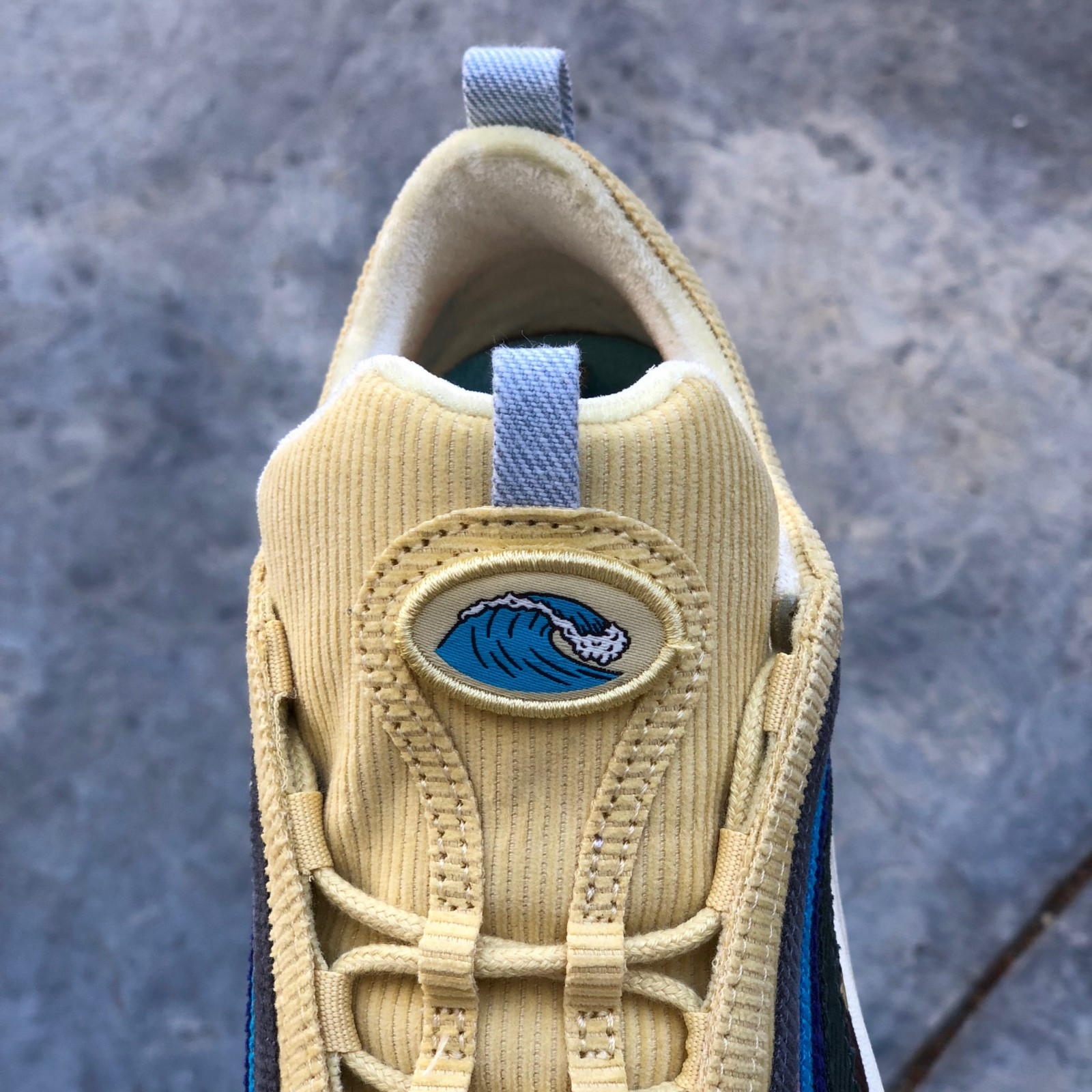 16cc957869 The velcro tongue tab of the shoe is colored in yellow and also made with  corduroy. The photo shows the iconic Air Max 97's hidden lace system and  the ...