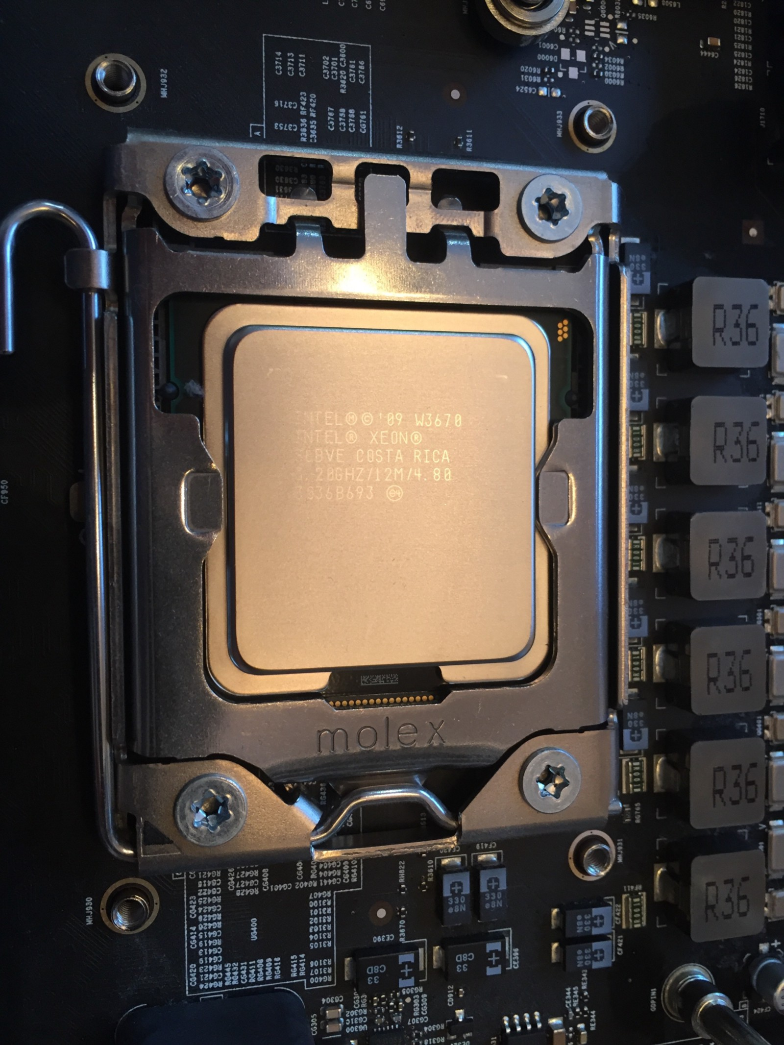Upgrading The Cpu In A 2009 Mac Pro Paul Lefebvre Medium Locking Circuit Board Support Spacer From Reliable And Placed Socket It Only Fits One Way With Slots Lined Up Closed Cover Then Lowered Locked Latch Into Place