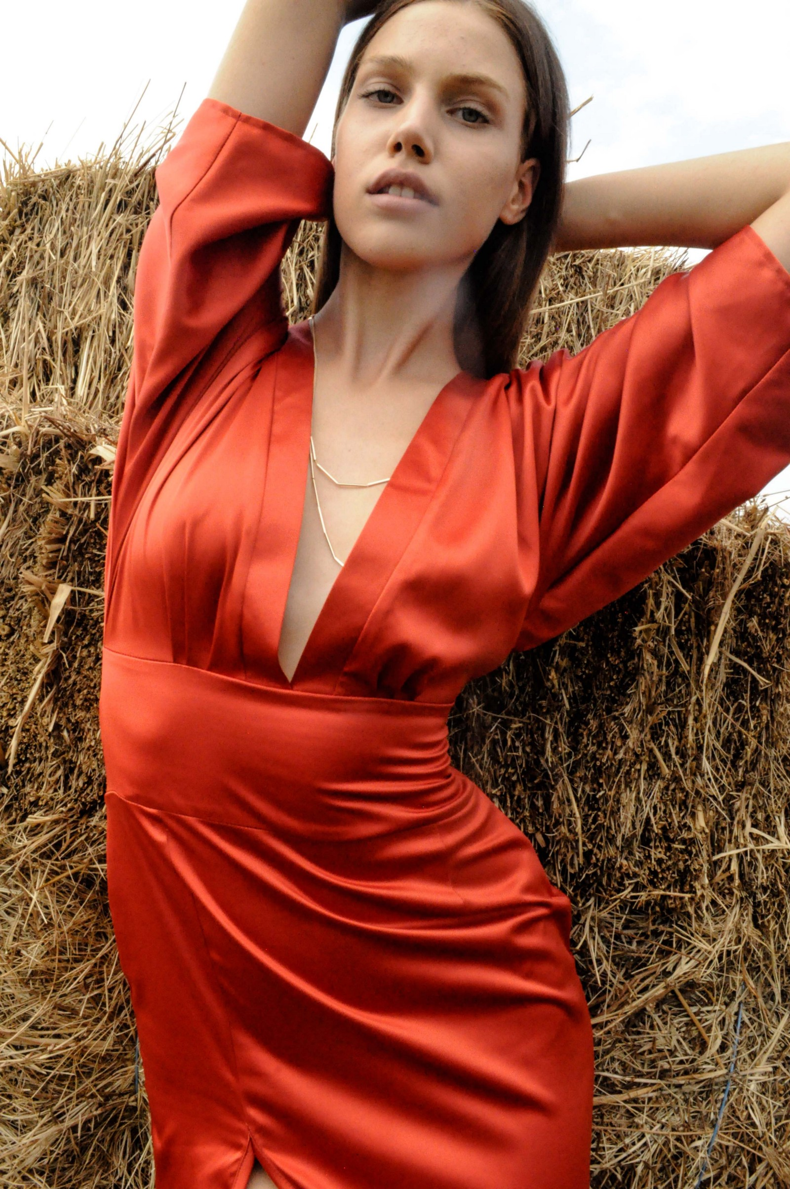 The model is wearing The Terra Cotta Maxi Dress