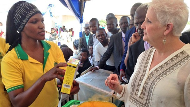 Feed the Future Uganda Youth Leadership for Agriculture agripreneur Fatuma Namatosi, left, explaining Byeffe's pumpkin-based products to U.S. Ambassador Deborah Malac, right, at a youth fair in Mbale, Uganda. /Byeffe