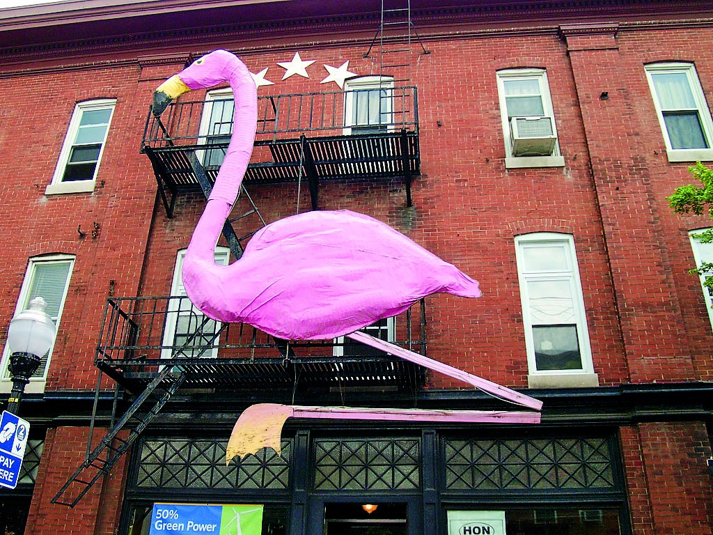"A giant pink flamingo sits among shops and restaurants on ""The Avenue"" in Baltimore's Hampden neighborhood."