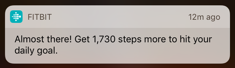 A cheery push notification from FitBit. It reads: Almost there! Get 1,730 steps more to hit your daily goal.