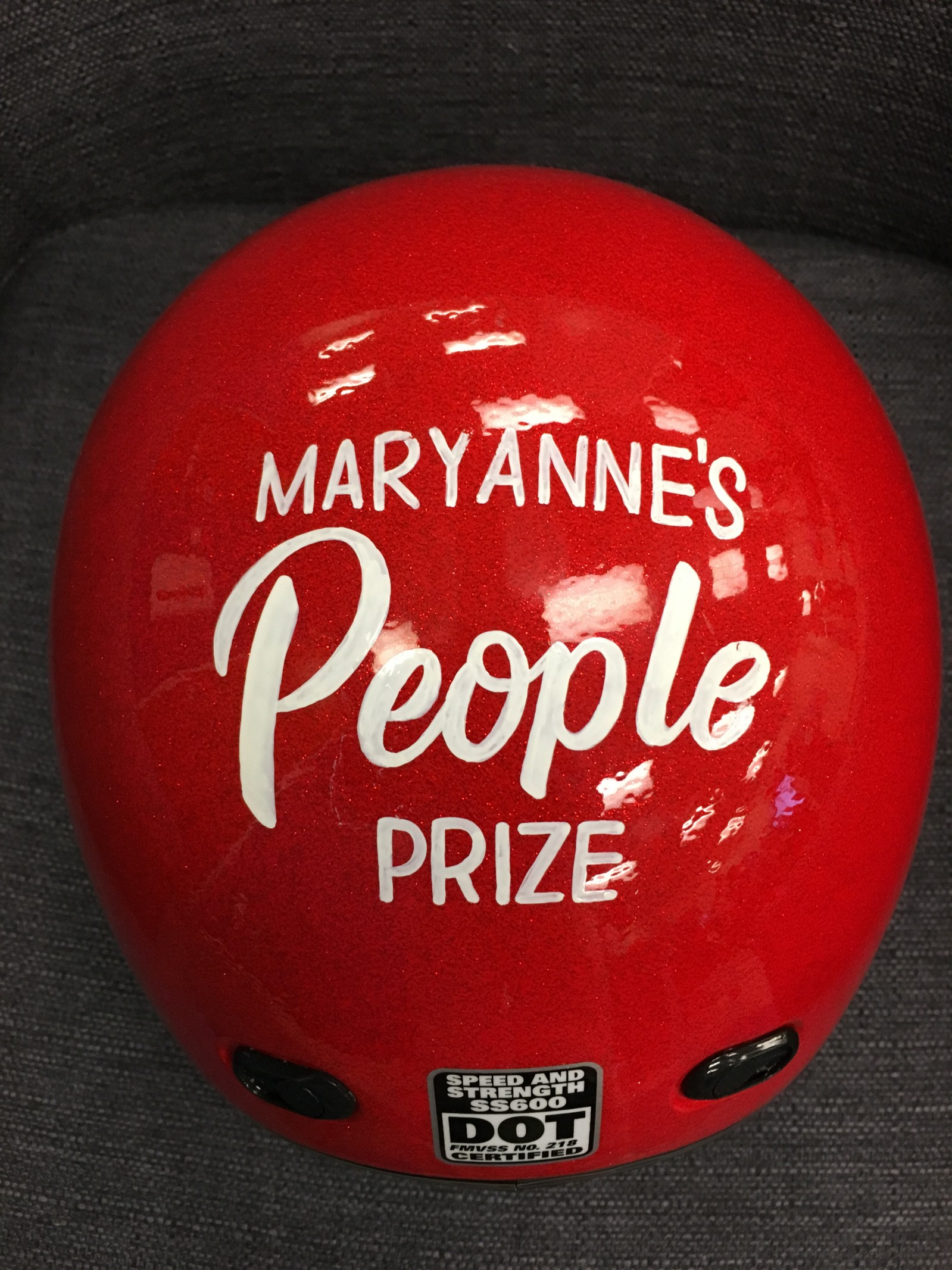 It's not a bowling ball. This prize is a fully functioning helmet.