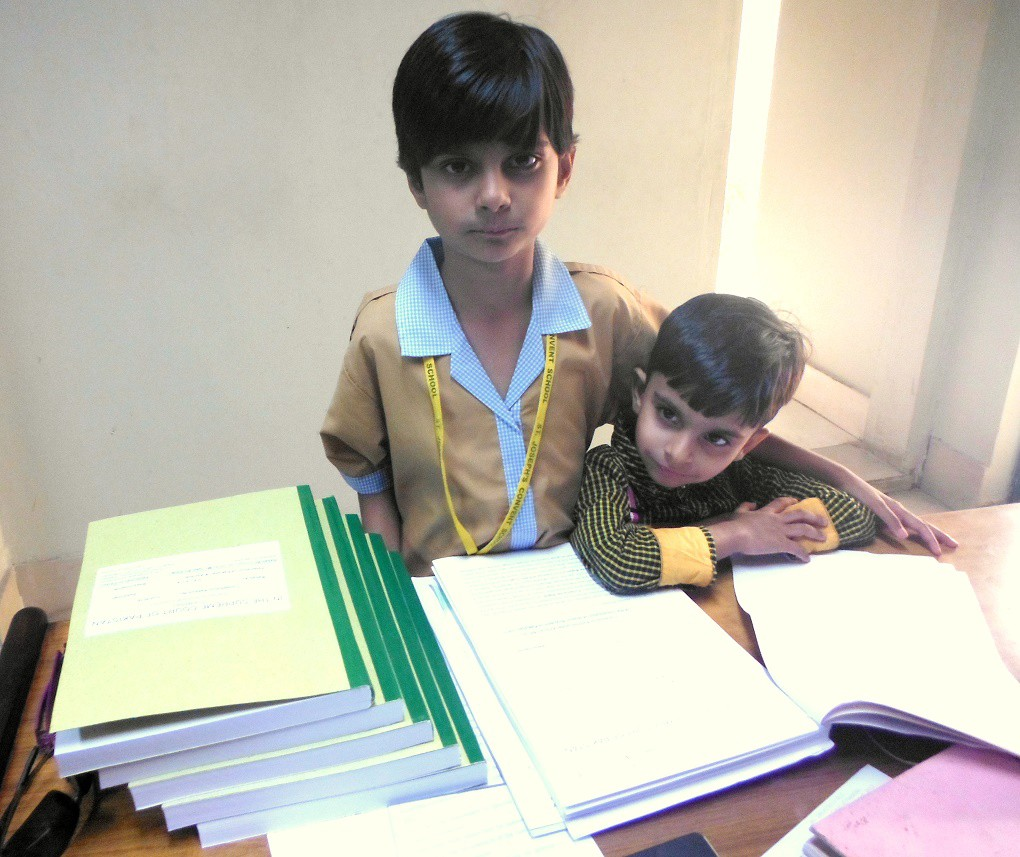 Rabab Ali, with her younger brother. Ali is suing the Pakistani government  for its exploitation of dirty lignite coal. Photo Credit: Qazi Ali Athar.