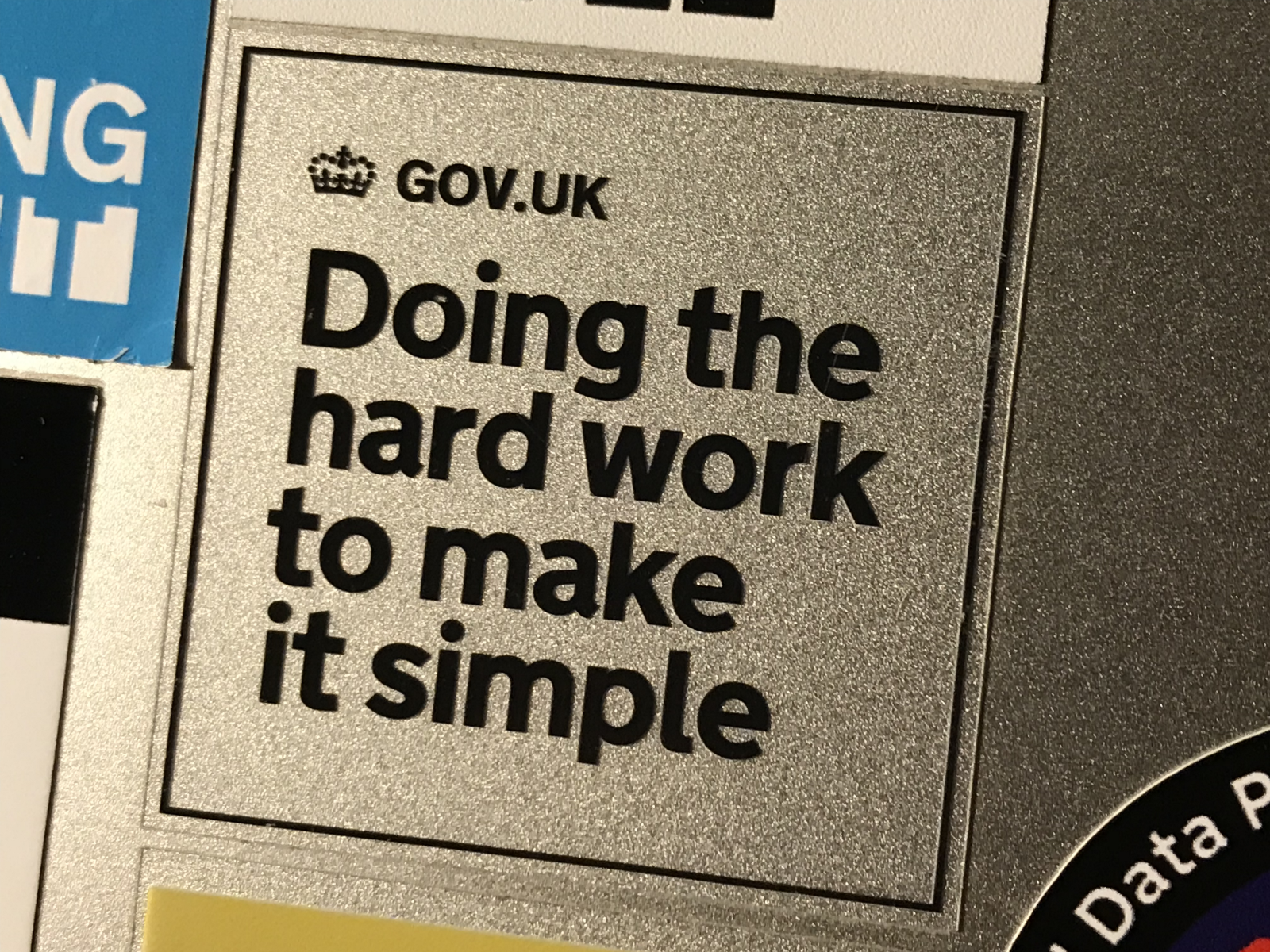 "Photo of sticker on a laptop with ""doing the hard things to make it simple""."