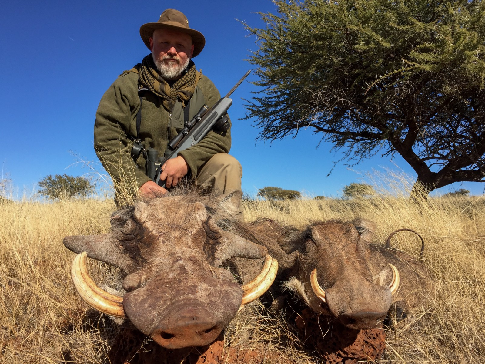 Scout Rifle Safari participant Robert Parker and two warthogs he took with  Hornady's Precision Hunter 308 Winchester load