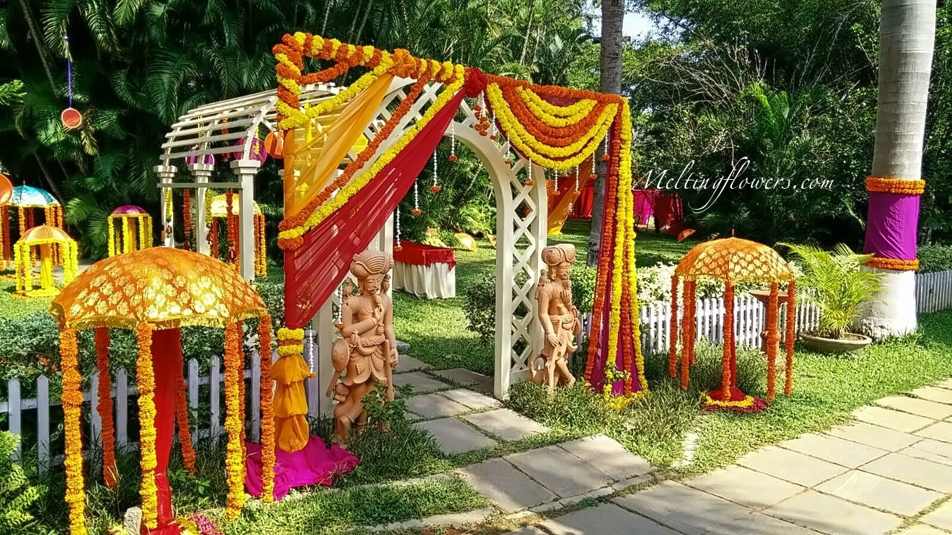 Know about few quirky non traditional indian wedding decoration ideas you can ask for a bangle bazaar theme where you can decorate the entire area with strands of colourful bangles genda flower strings in wavy pattern and junglespirit Images