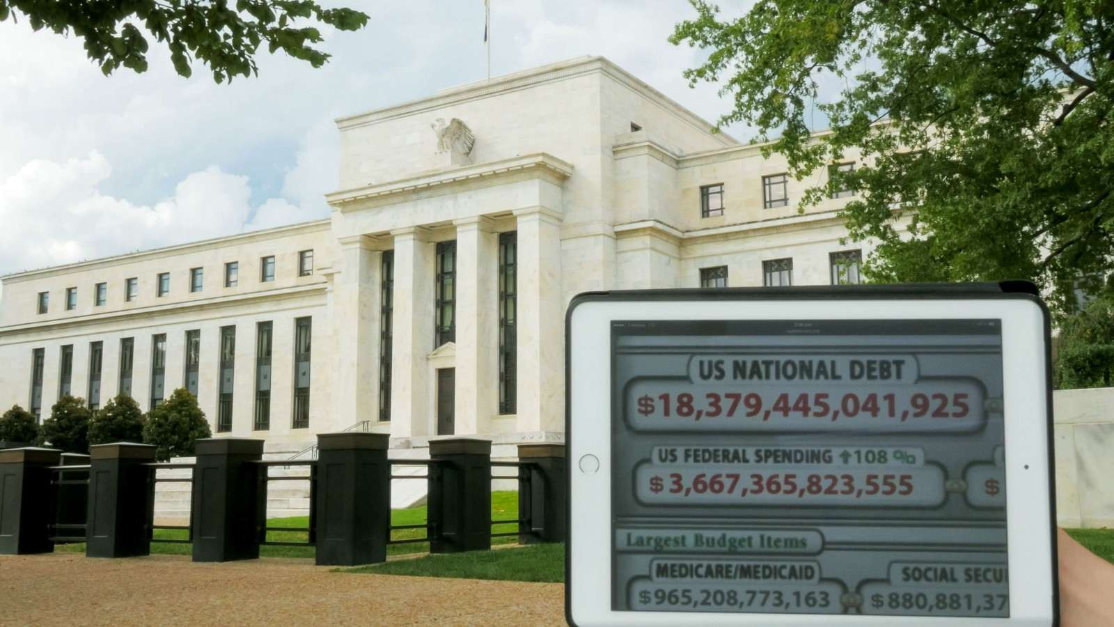 National Debt Clock and federal spending information overlayed in front of a government building