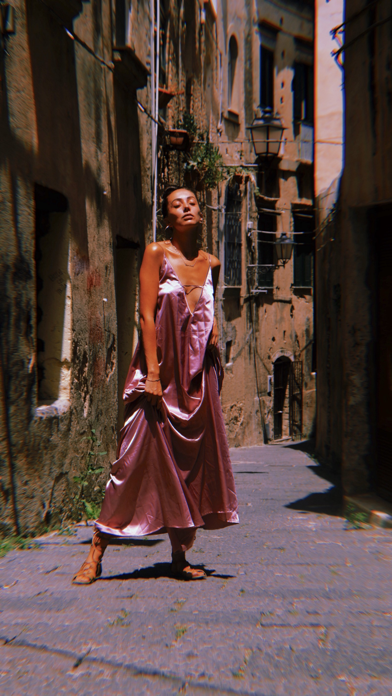 Gabriella Piccolo wearing the pink silk maxi dress by Bastet Noir