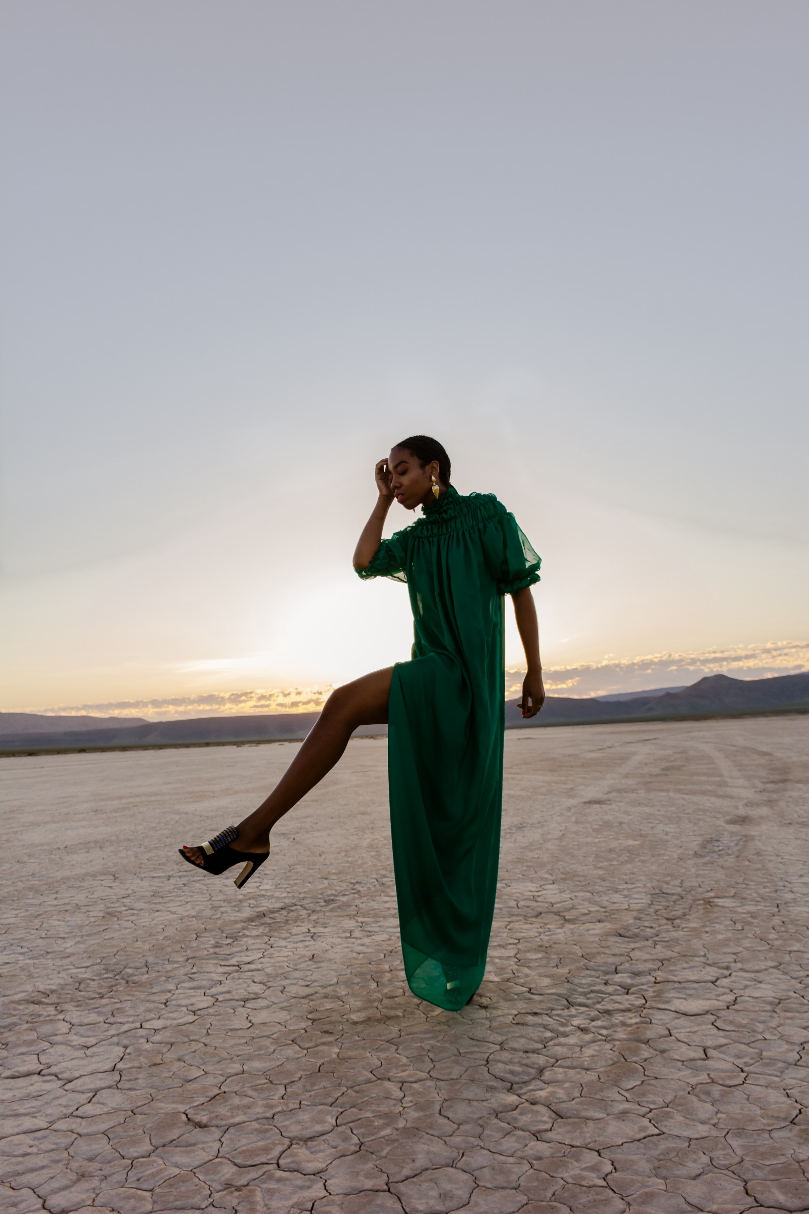 Thaina Blot wearing the emerald green turtleneck maxi dress with side slit