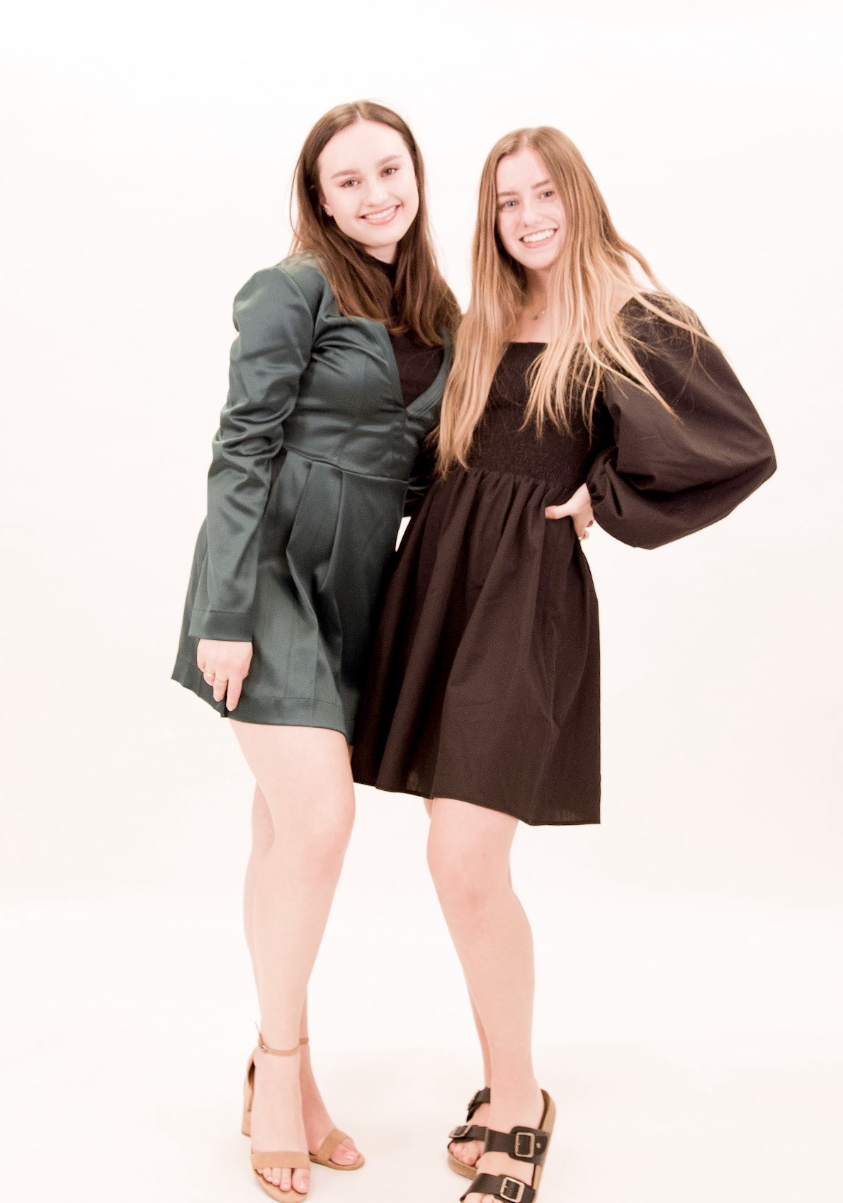 Isabel and Caroline Bercaw, founders of Da Bomb Fizzers wearing custom-made Bastet Noir dresses