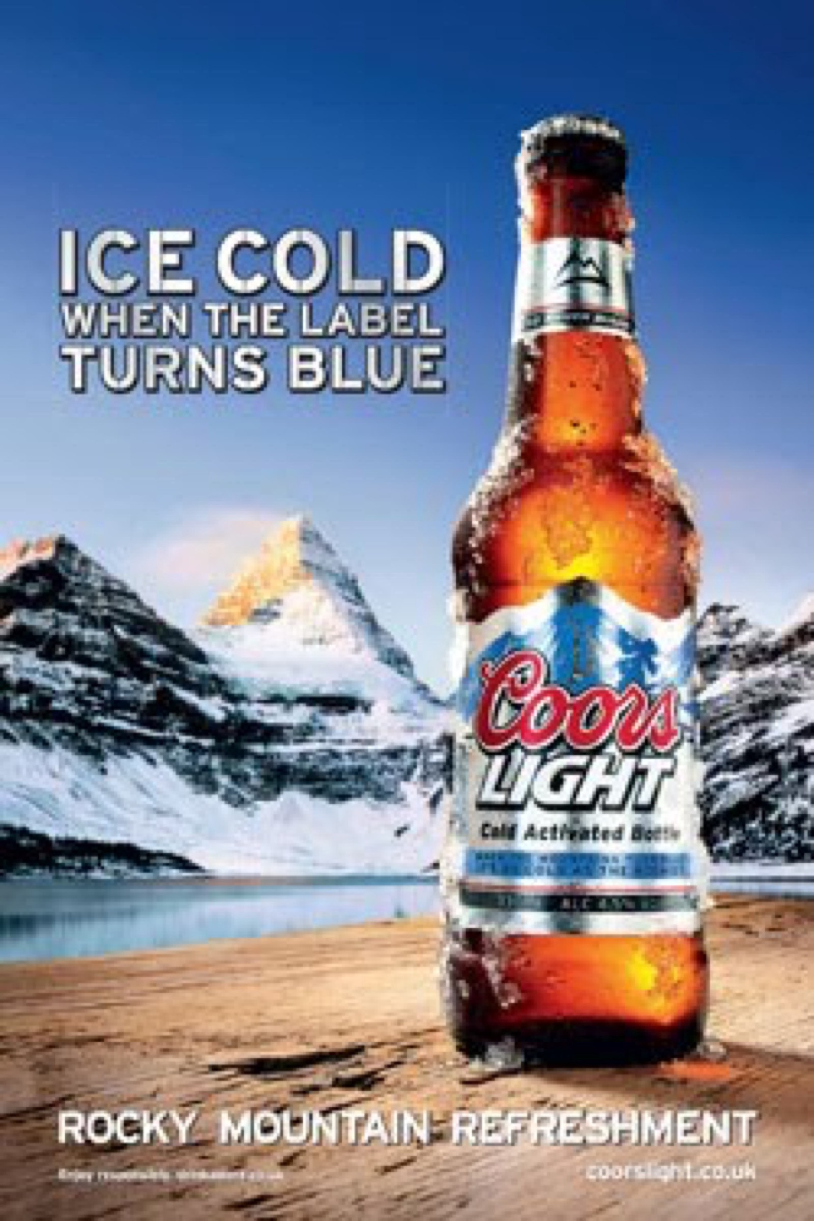 Nice This Advertisement Is For The Ice Cold Coors Light Beer. The Bottle Has Ice  Running Down Its Side, While It Is Placed In Front Of The Frosted Rocky ...