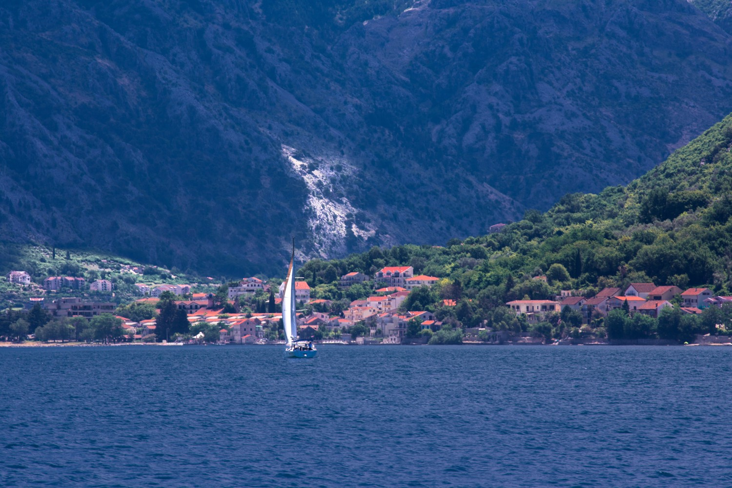 Sailboat in the Bay of Kotor near the town of Perast