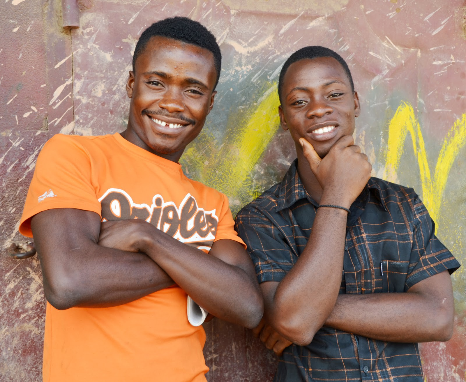 From left: Thomas Sieh and Milton Karmen, who both lost parents to Ebola are now off the streets in Doe Community, Liberia, back in school, and finding new hope for the future with the help of USAID-supported counseling and mentoring. / Jessica Benton Cooney, USAID