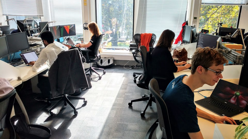 The team working at desks in the ISD office