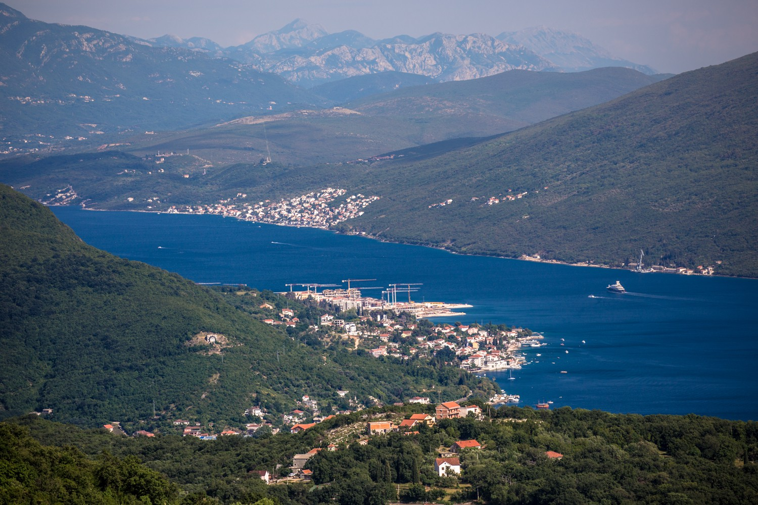 The mouth of the Bay of Kotor, with a cruise ship sailing in
