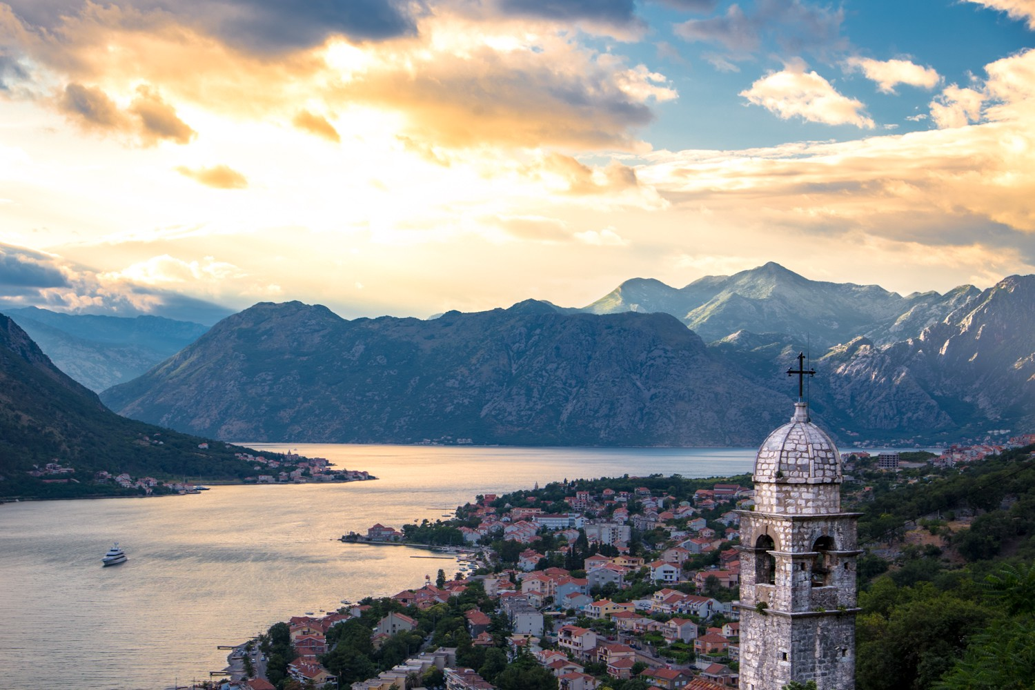 Climbing the steps up Kotor fort with a view of Kotor Bay sprawling below us, Montenegro.