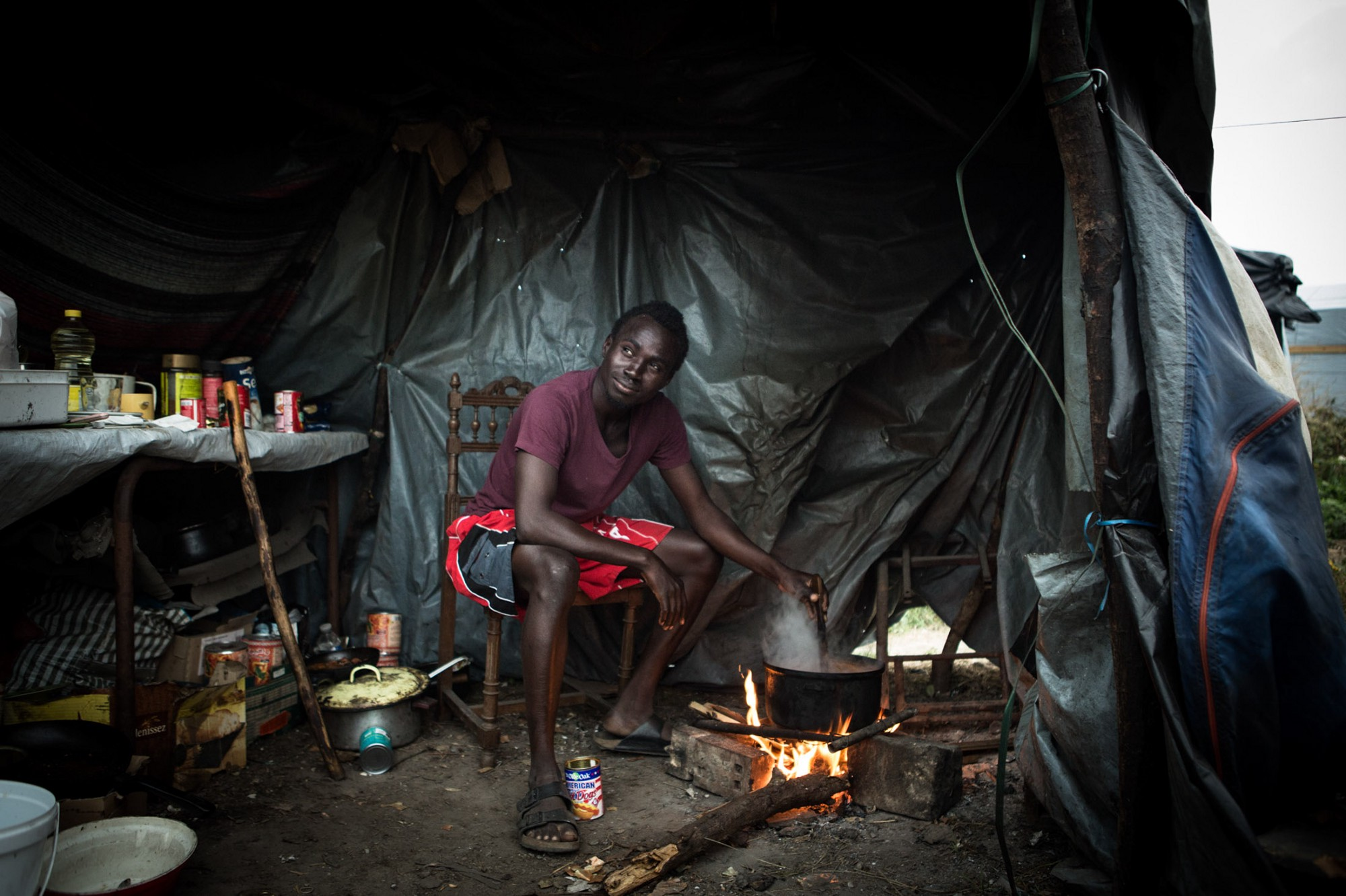 """Nasraldeen cooks chicken and sausage """"damaah"""" with pooled resources from his fellow countrymen in a communal kitchen"""