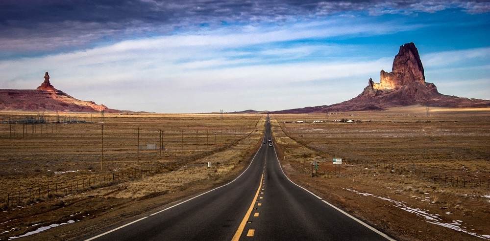 Road towards Monument Valley at sunrise